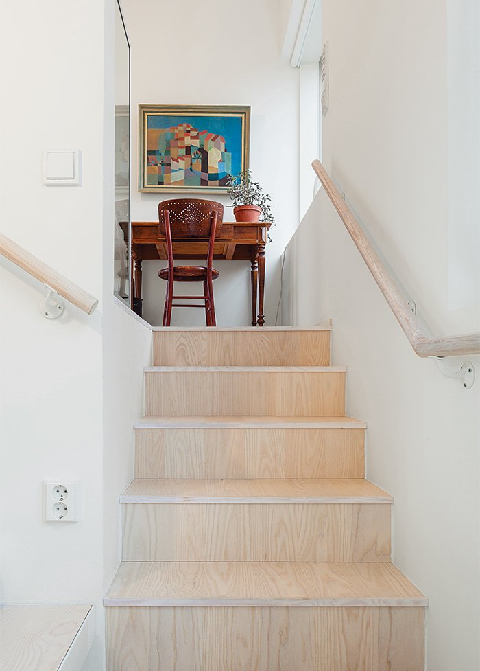 Staircase and Wood Railing The flooring and stair risers are European ash, treated with a varnish that was tinted one percent white.  190+ Best Modern Staircase Ideas from This Cozy Finnish Home Would Not Be Complete Without a Sauna