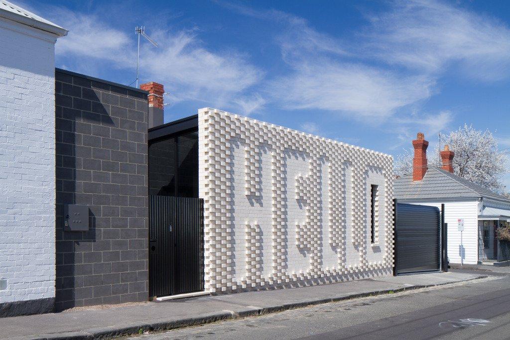 Hello House white brick exterior facade