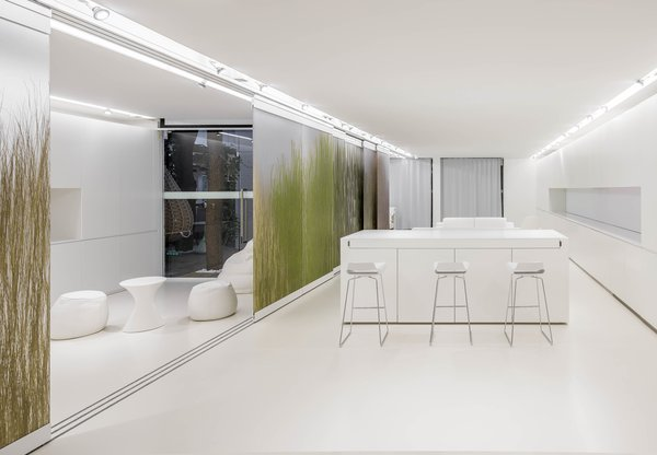 "NArchitekTURA chose a monochromatic white interior for its ""Apartment of the Future—R&D Laboratory"" in Dobrodzień, Poland, taking a cue from the design of contemporary cellphones and other mobile devices."