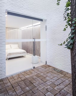 A view of one of the bedrooms from a courtyard.