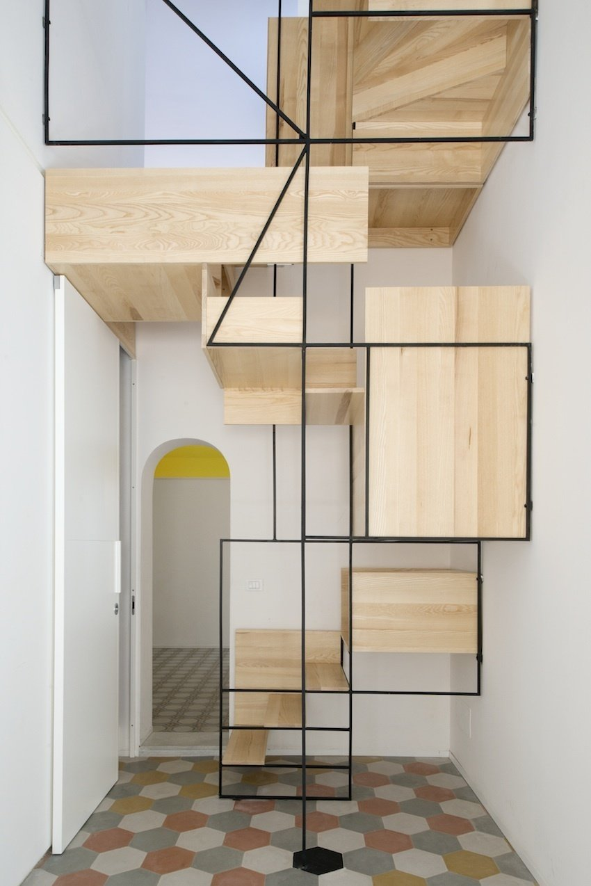 The oak-and-steel structure, as much a sculpture as a set of stairs, animates the interior of this slender, multi-story building.  190+ Best Modern Staircase Ideas