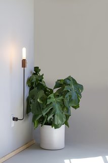 Designed and made by the Los Angeles studio Feltmark, the Wald plug lamp occupies a middle ground between floor lamp and wall sconce.