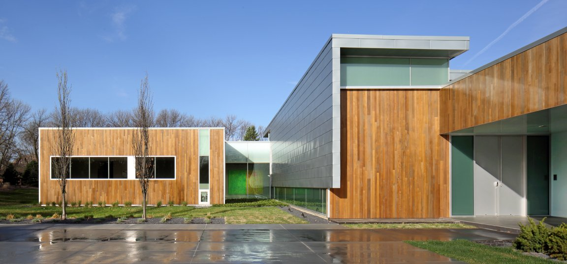 """The most challenging aspect of the project was the client's directive to 'design an art gallery we can live in,'"" says architect Jeff Dolezal of local firm Tack Architects. Though the house is quite large—over 10,000 square feet—it was constructed with green design principals in mind. It features low-VOC paints and interior finishes, locally sourced materials, blown in soy-based spray foam exterior insulation, skylights and solatubes for natural daylighting, and FSC certified lumber, and LED light fixtures. The exterior is clad in zinc and cedar.  Omaha Art-Inspired House by Diana Budds from Modern Dwellings in the Midwest"