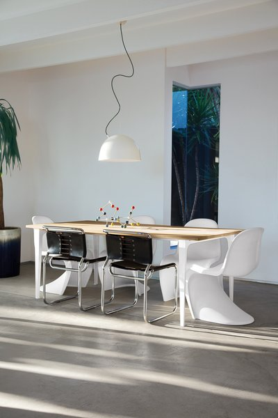 The couple hand-selected every piece of furniture in the house and perused Craigslist to find the four Verner Panton stacking chairs surrounding a Pure dining table from CB2. The two tubular steel side chairs are from Danish Modern L.A., and the pair purchased Muuto's Plugged Pendant lamp from A+R. Mays and Campbell received the Molecule Building Set as a gift; it's available from Ferm Living.