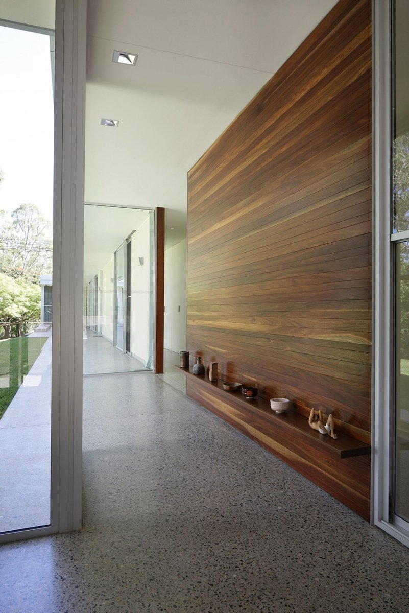 Hallway and Concrete Floor Australian residence, John and Cathy Dillon drew from mid-century modern ethnic influences to design their dream home. Photo by: David Sandison  Hallways That Impress from The Long Hall