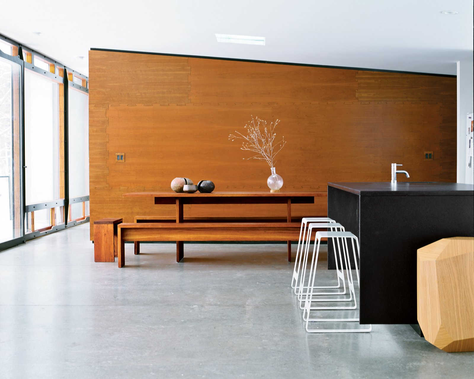 Dining Room, Bench, and Table The table in the dining area was found in Venice, California, and the geometric table is a prototype by Arik Levy.  Photo 5 of 12 in A Hybrid Prefab Home in Upstate New York from Interior Designers Speak: 18 Common Design Mistakes to Avoid