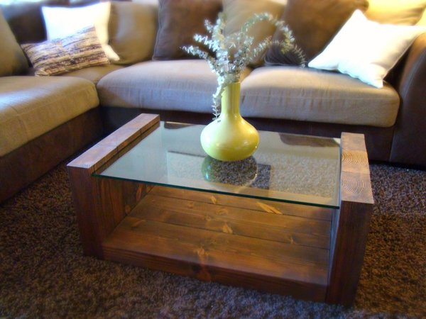Glass-topped dark walnut coffee table by Dolenz and Daughters.
