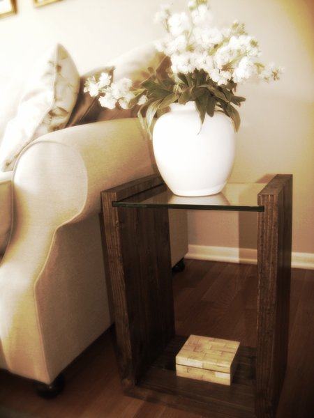 Glass-topped dark walnut end table by Dolenz and Daughters.
