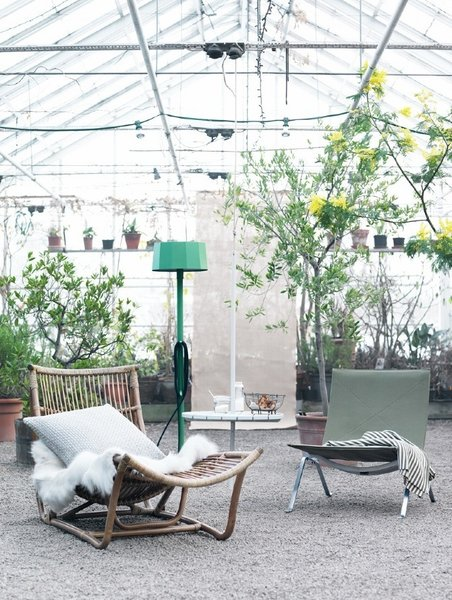 """A greenhouse lounge area shot. """"I am very inspired by nature and love to include flowers and green plants in my styling,"""" says Hellberg. Photo by: Petra Bindel"""