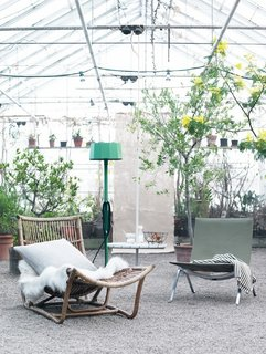 "A greenhouse lounge area shot. ""I am very inspired by nature and love to include flowers and green plants in my styling,"" says Hellberg. Photo by: Petra Bindel"