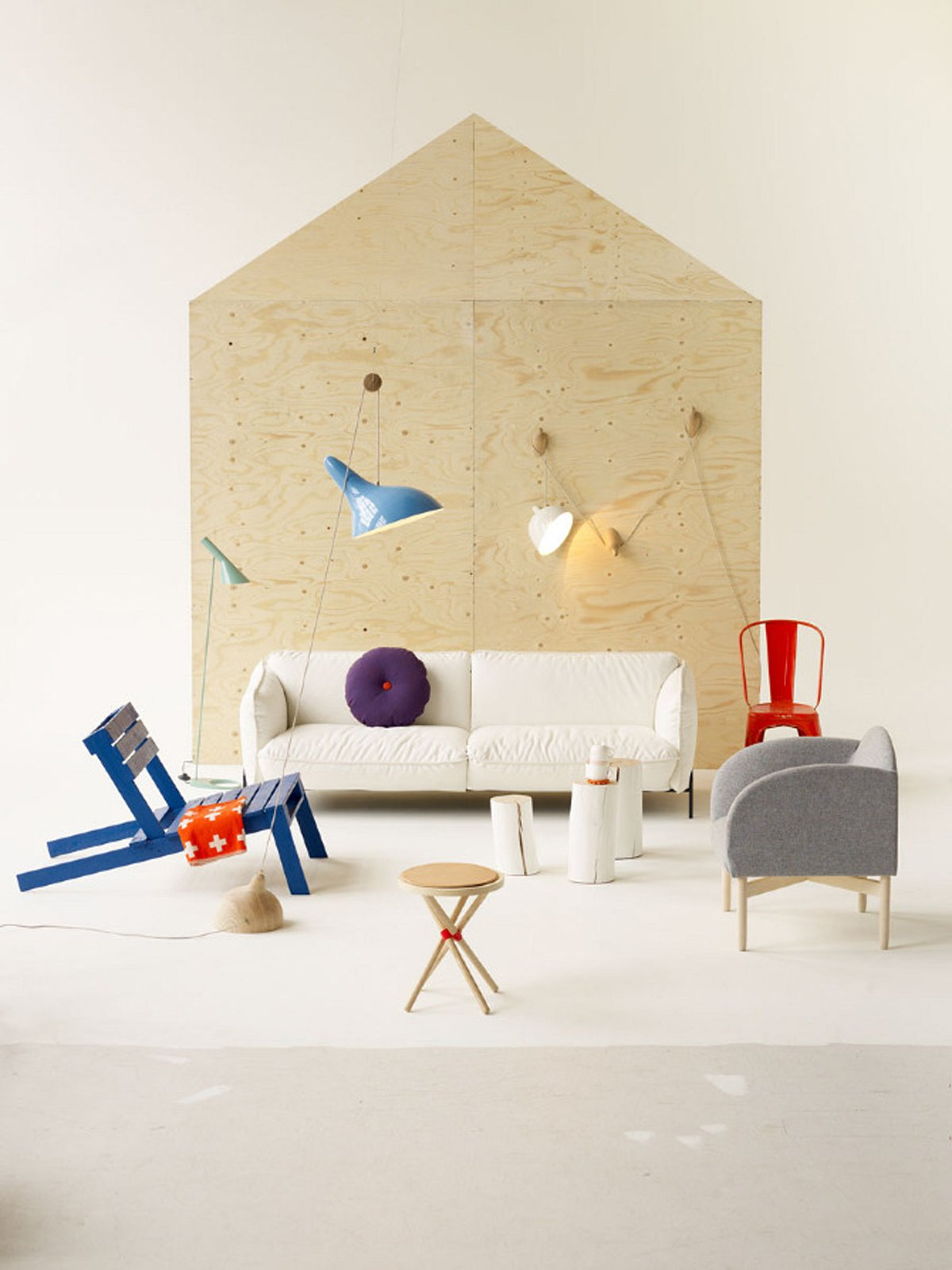 """The Scandi House is a modern furniture lover's dream—painted Drawing Room Blue by Farrow & Ball wooden chair made after a description by Nina Tolstrup of Studiomama, small blanket by Pia Wallén, Couch Continental by Claesson, Koivisto, Rune for Swedese, Cushion Dot by Hay, white wooden logs by Paola Navone, Kinto teapot set from SLOWFASHIONhouse,  AJ Floor Lamp by Arne Jacobsen for Louis Poulsen, vintage orange Tolix chair, grey Moln(Cloud) armchair by Anderssen & Voll for Stolab, Rondo Stool by Jakob Thau for Källemo, and Francis lamp wall installation by dmoch. Photo by: Per Ranung  Search """"our scandinavian style dreams come true brooklyn town house"""" from Styled by Tina Hellberg"""