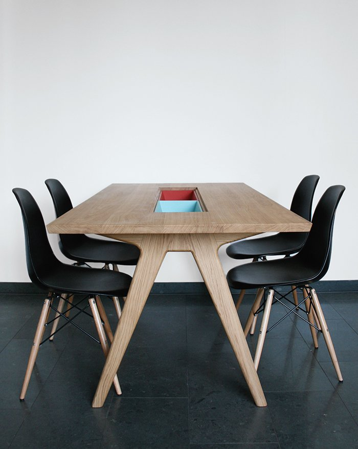 """Dining Room, Chair, and Table Paired with Eames side chairs, her dining table includes two cases """"to either hide or show things,"""" she says.  Photo 12 of 14 in Modern Furniture Designer Continues Her Family Tradition"""