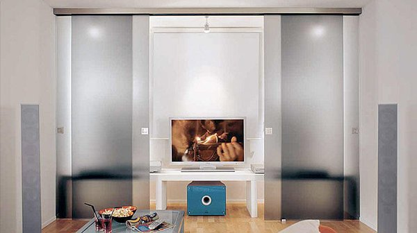 This interior sliding door hardware can be used in many different applications; (i.e. single, double bi parting, double bi passing, ceiling or wall mounted, etc). It has a slim and sleek stainless steel look valance that hides the track and wheels. This system is used with 3/8 (10mm) frameless glass doors only and can be recessed into the ceiling or exposed on the wall.  retailer: Bartels Doors  price: available upon request