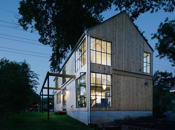 """The exterior features vertical, untreated cedar panels. """"We tried to use materials that are beautiful in their natural state without excessive treatment or finishing,"""" Pavonetti says."""
