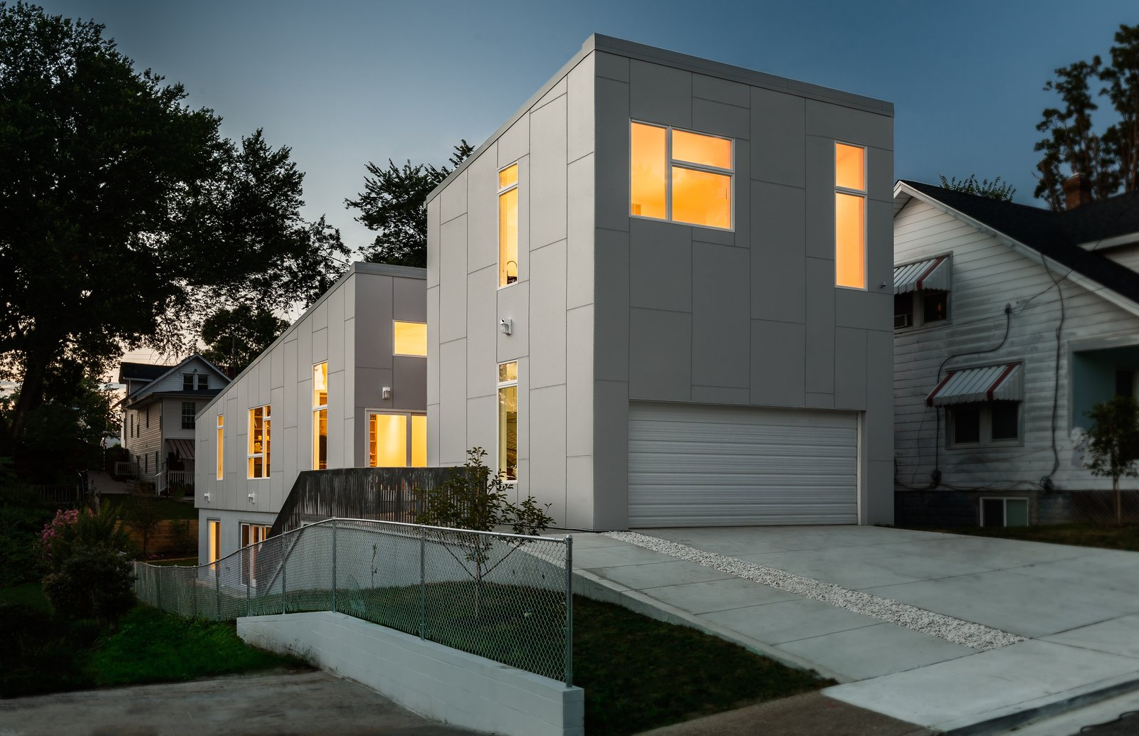 The house, shown here from the street, was designed for two full-time residents and to accommodate visiting children and grandchildren. Its name—the 10 Degree House—comes from the roof's angle.  Photo 6 of 11 in Secret Garden