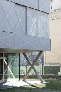 """Perforated steel panels provide a contrasting sense of roughness and lightness, which Oman played with throughout the home's design. The skin adds transparency and graphic energy to the exterior, though Oman did worry about people fixating on the tic-tac-toe element. """"It's like calling a rectangular building the Tetris house,"""" he says."""