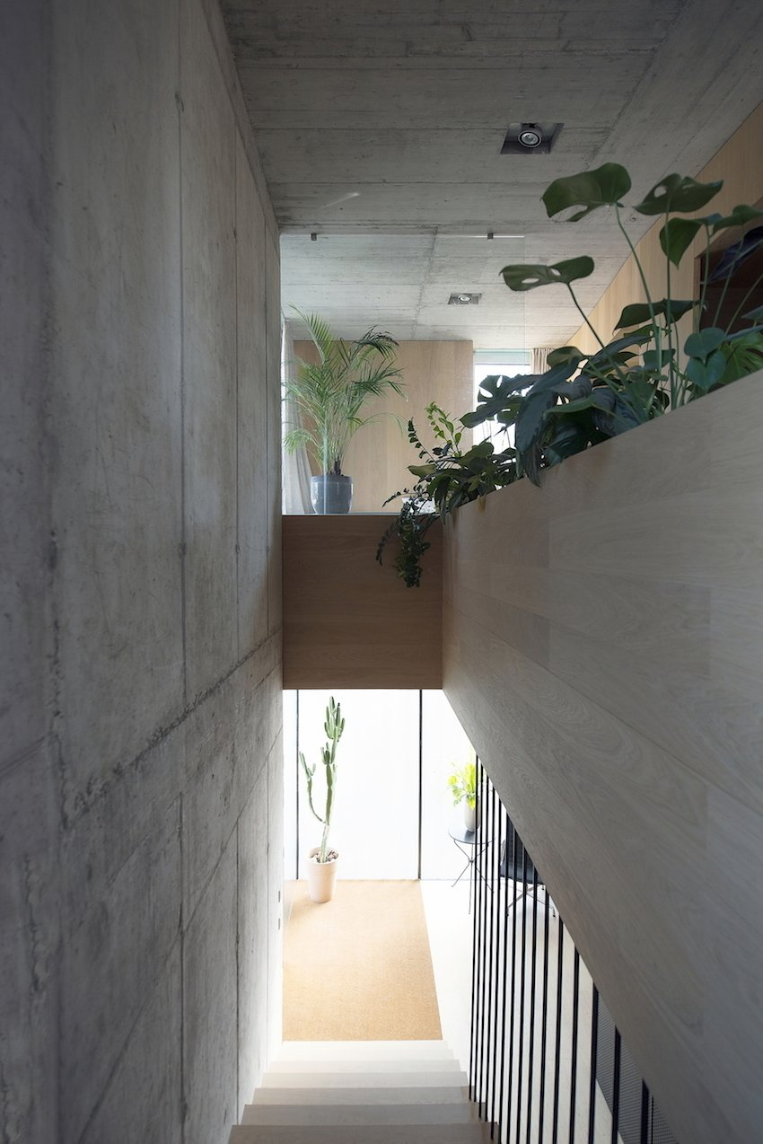 The 3,700-square-foot space includes a rainwater collection system and heat pump, and thanks to the double-panel facade, is both well-insulated and energy efficient.  Photo 8 of 10 in Super Minimal Steel and Concrete Villa with an Unusual Facade