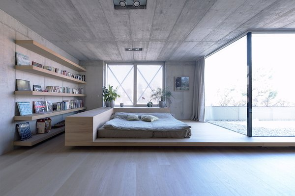 The simple yet spacious master bedroom opens up to a private terrace.