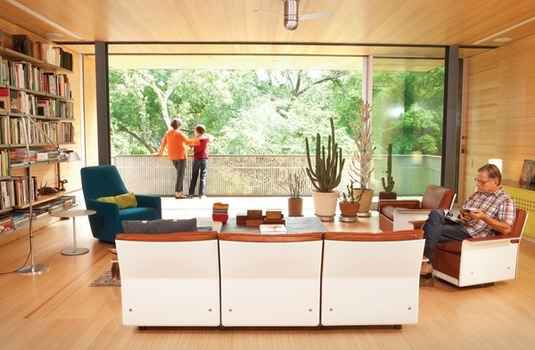 "Native Texans and married designers Elizabeth Alford and Michael Young came home to roost 10 years ago, when they ditched big-city life in New York for a ranch house in Austin. The couple immediately knew that the home, originally built by architect Jonathan Bowman in 1957, would need a remodel, but realized that a complete restoration would be too costly and perhaps ""not that satisfying"" for the designers to work solely within the existing structure. So they stripped it down to the footprint and rebuilt, shaping a family home that would reflect both the hypermodern lives they left in New York City and the deep-rooted cultural heritage that comes with growing up in Texas."