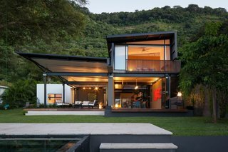 """""""The house plan is composed of a grid with alternating interior and exterior spaces, so that every interior space is adjacent to at least two exterior ones,"""" architect Roberto Javier Dumont says. Designed as a weekend house for a family that lives in San Salvador, the retreat totals 3,500 square feet."""