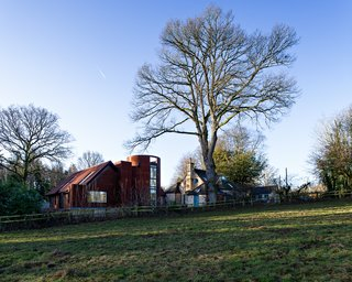 """An envelope of Cor-Ten steel clads the structure's timber frame. """"We drew on and referenced the use of corrugated steel sheet in 20th-century agricultural buildings and the way rusted steel fits into the existing range of materials in this area,"""" Whittaker explains. It was difficult to find a supplier in the UK, though, as Cor-Ten is much harder than typical steel and manufacturers can be wary of producing it. In the end, the team was able to procure it locally from Hollywood Design in London."""
