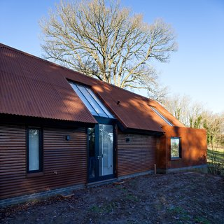 The home's carbon footprint is small. The architect installed green technologies like Warmcell Insulation, made from recycled waste paper, and an external air source heat pump, which absorbs warmth from the outside and transfers it to a subfloor system. Other sustainable features include passive ventilation, roof-mounted photovoltaic panels, a biomass boiler room, and rainwater harvesting systems.