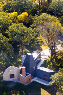 """""""Early in his career, Gehry was able to experiment with his own home—deconstructing rooms and functions into the shapes of the actual residence—and explore materials which are non-traditional,"""" says Christy MacLear, Executive Director of the Robert Rauschenberg Foundation. """"The Winton Guest House happens in '87, and is the step between his own home and his commission at the University of Minnesota in '90 where he moves his deconstructionist style toward what we see in '97 in Bilbao."""""""