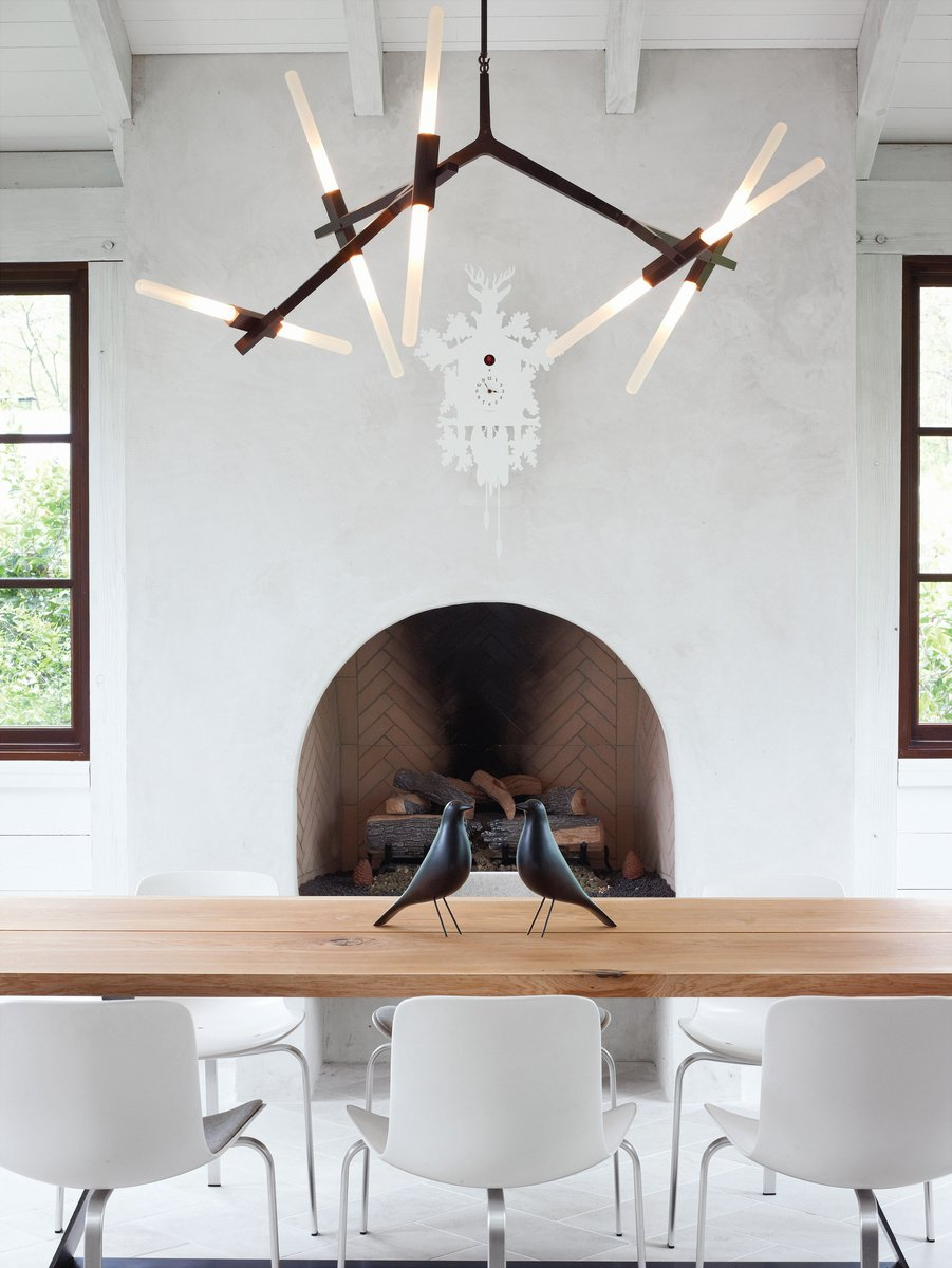 Barbara Hill designed this modern home in Atlanta, Georgia. Its informal dining space has a slightly rustic feel, sporting bronze and wood in the form of a Lindsey Adams Adelman chandelier for Roll & Hill.  127+ Inspiring Interior Ideas