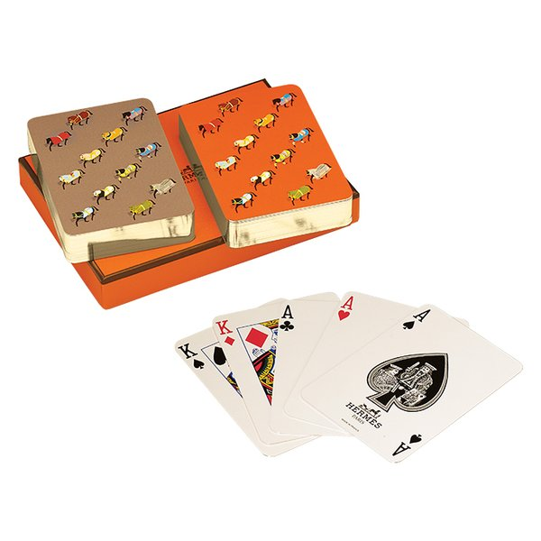 What's your go-to host gift?   You can't go wrong with Hermès playing cards. Parade bridge playing cards (set of two) by Hermès, $100.
