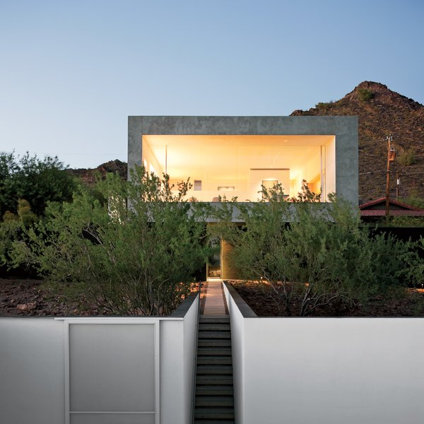 """Phoenix Rising-The award-winning Phoenix home received an update from Wendell Burnette with a complete hardscape and landscape renovation incorporating native plants and a pool that """"projects toward the canopy of the desert sky."""" Photo by: Dean Kaufman"""