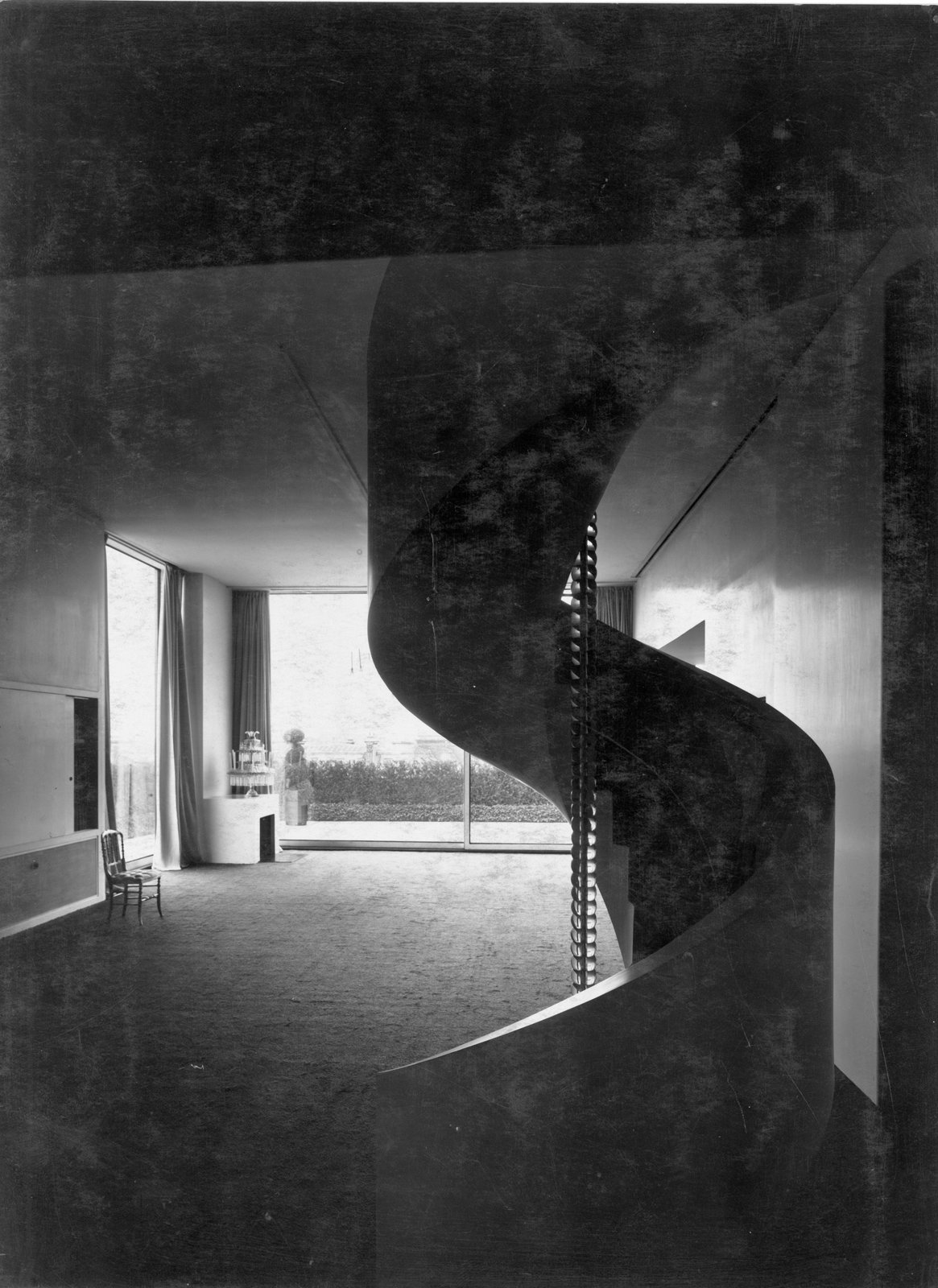 Charles de Beistegui, a collector living in Paris in the 1930s, commissioned Le Corbusier to design a spectacular penthouse apartment for him on the Champs-Élysées. Though the home no longer exists, save for archival black-and-white shots, Michael Herrman was greatly inspired by it. Seen here, a spiral staircase in the living room of Beistegui's apartment.  Photo 10 of 11 in A Corbusier-Inspired Parisian Home