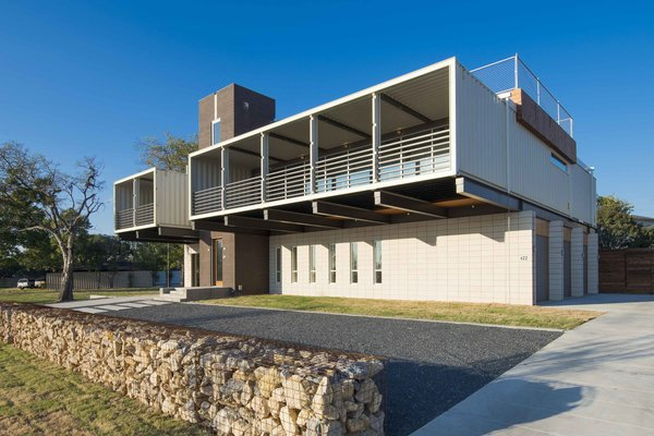 The 40-foot-long containers hang 16 feet over the ground. The deep balcony, Gooden says, offers solar protection, keeping strong sunlight out but letting natural light in.  The home has three bedrooms, a den, and three and half baths.