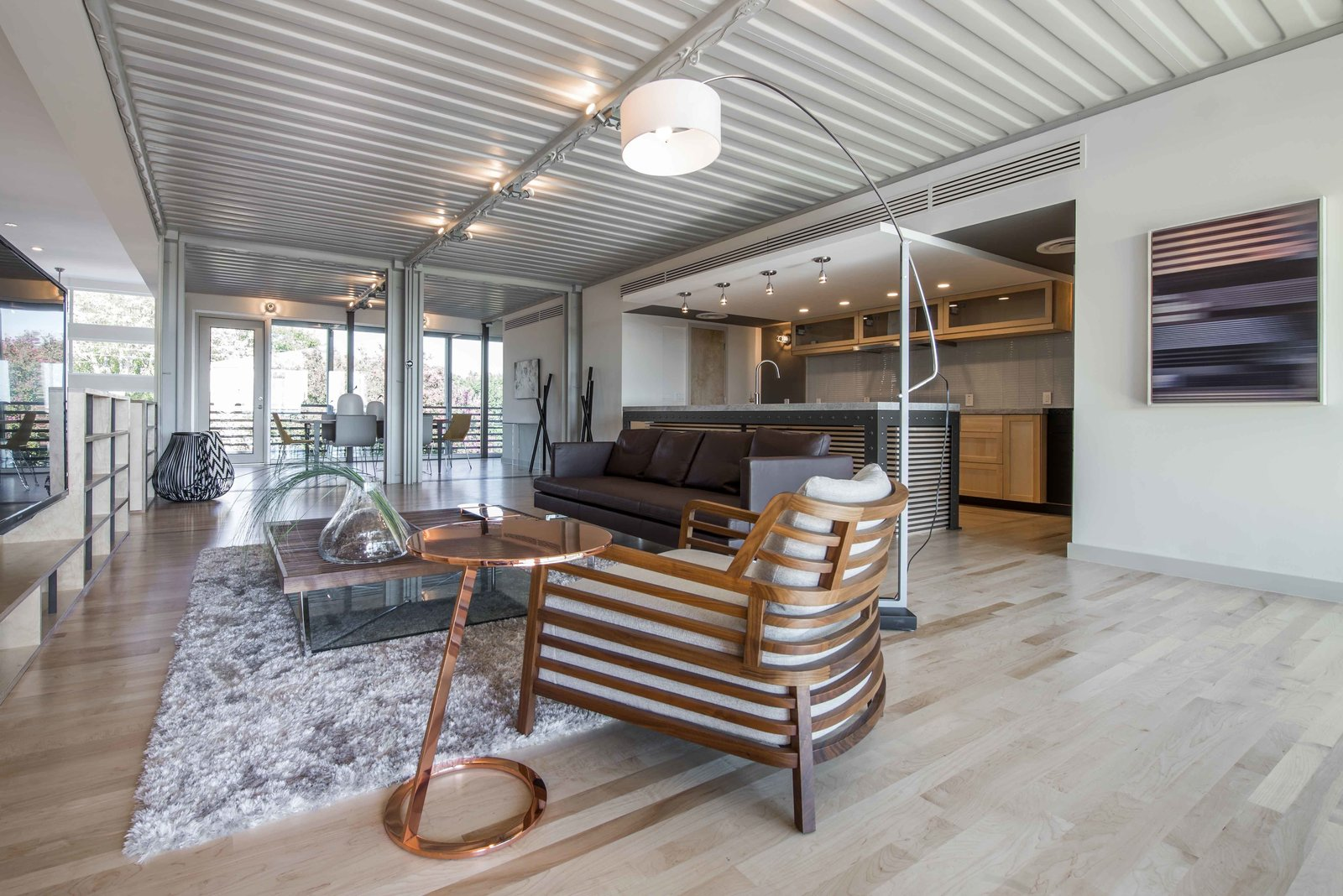 Corrugated steel ceilings are left exposed—a reminder that this is, after all, a container converted into a home. Spray foam insulation keeps the space from experiencing extreme temperature shifts.  This House Was Built Out of 14 Shipping Containers by Esha Chhabra