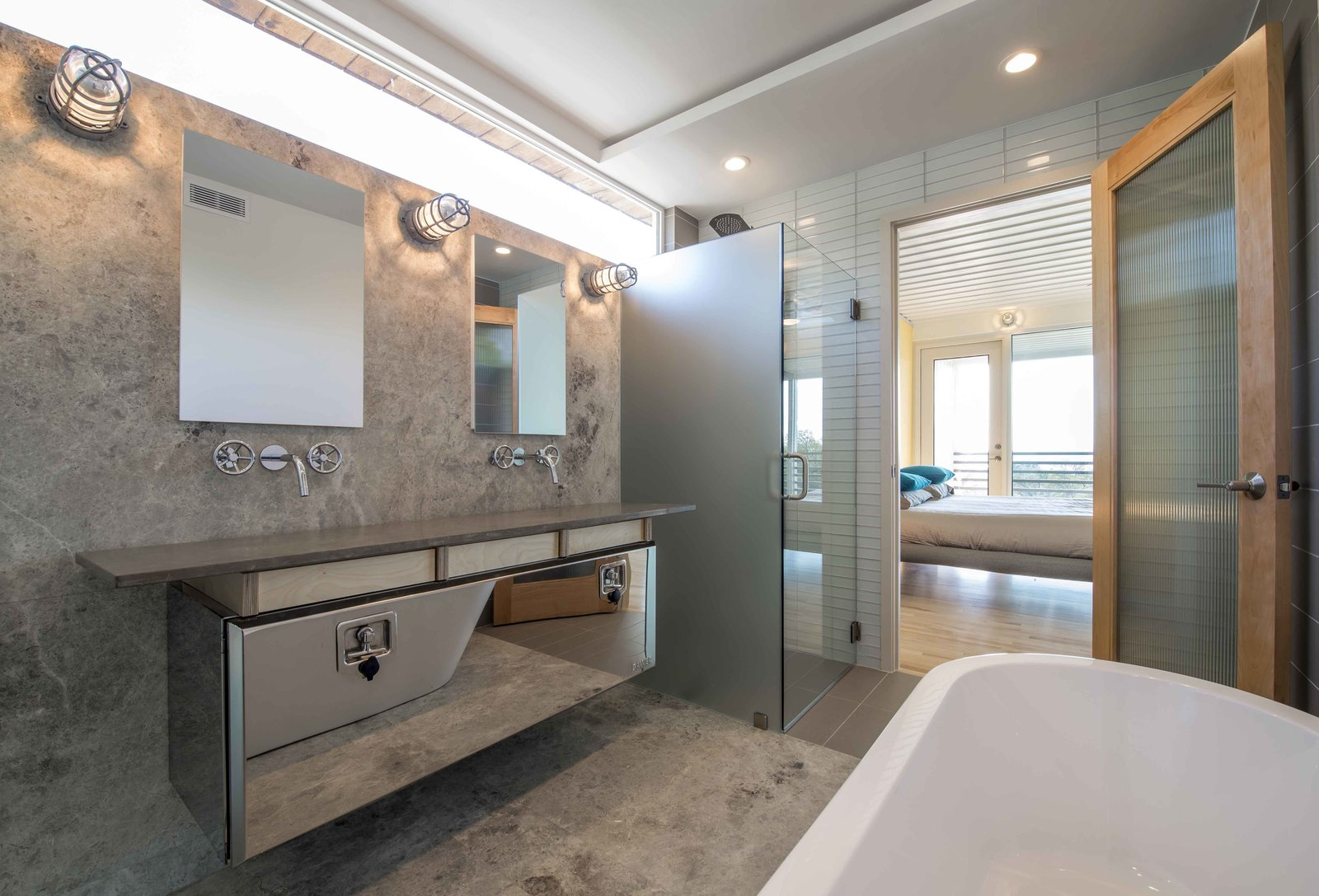 Bath Room, Freestanding Tub, Enclosed Shower, Corner Shower, Wall Lighting, and Ceiling Lighting The industrial thread continues as a truck tool box converts into an elegant vanity in the master bathroom.  Photo 6 of 9 in 14 Shipping Containers Were Upcycled For This Dallas Home