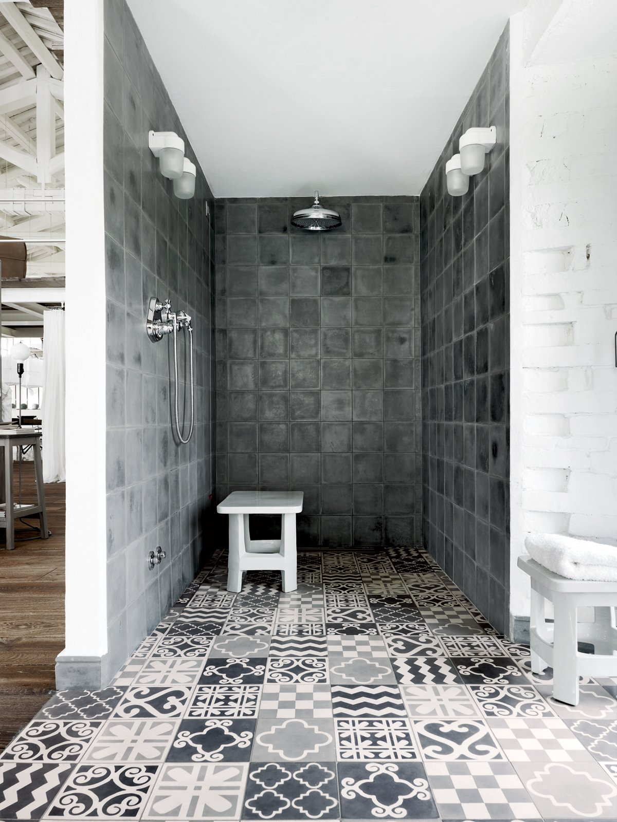 Bath Room and Open Shower In the shower: custom Carocim tile, created in Morocco.  Photo 2 of 13 in 11 Examples of How to Incorporate Traditional Building Materials Into Your Modern Home from Paola Navone's Industrial Style Renovation in Italy