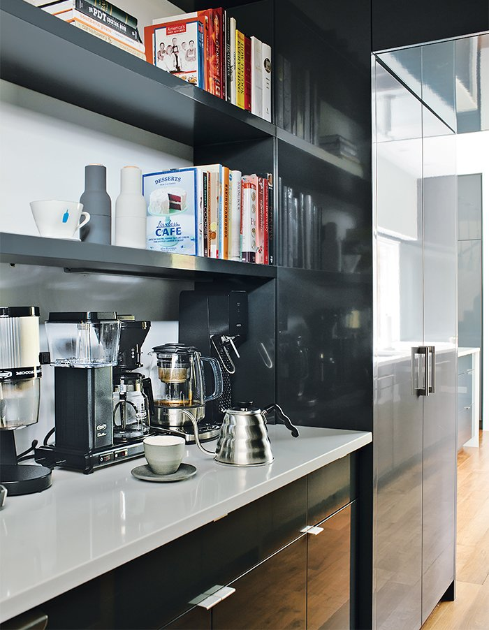 Kitchen and Beverage Center The firm also designed the kitchen, which was fabricated by Thomson Cabinetry.  Photo 7 of 13 in Minimal North Carolina Home Built for a Tech-Forward West Coast Couple