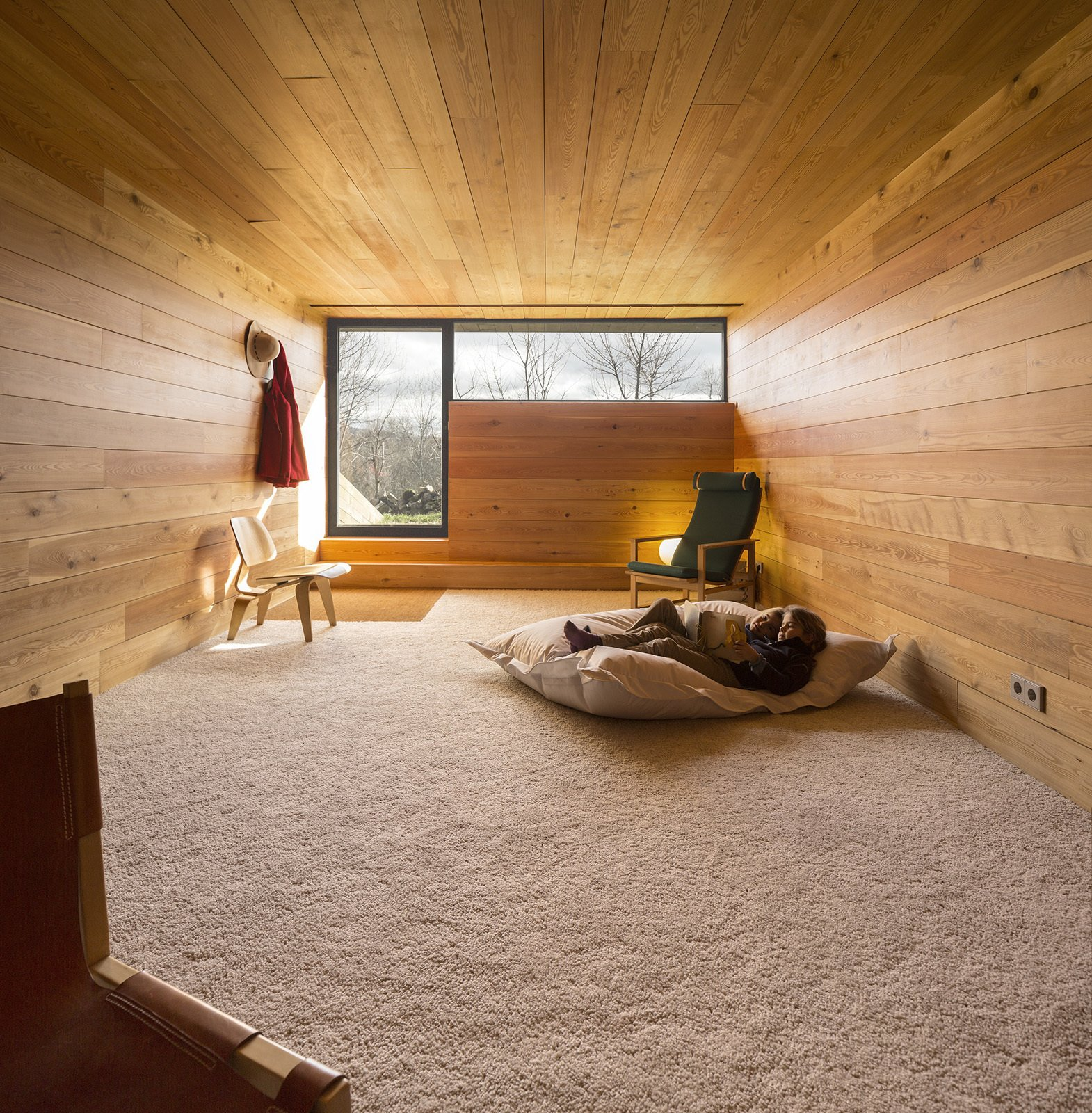 Kids Room and Bedroom Room Type Downstairs, bedrooms and a library offer private spaces. Wide-plank blond wood wraps the walls, floors, and ceilings, creating a cozy shiplike experience.  Refuge by Diana Budds from House of the Week: Timber Box Home in the Middle of the Spanish Countryside