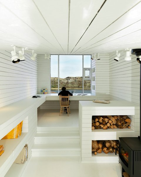 A white-filled (not to mention light-filled) interior bring the minimalist design inside. Newfoundland, Canada. By Saunders Architecture from the book Rock the Shack, Copyright Gestalten 2013.