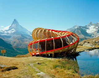 Livable sculpture at its finest. Created for the Zermatt Festival, an annual festival of chamber music, this structure (designed by a team of second-year architecture students!) maximizes the beauty of its surroundings with its 720-degree spiral composition. Valais, Switzerland. By Alice Studio/Atelier de la Conception de l' Espace from the book Rock the Shack, Copyright Gestalten 2013.