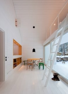 During snowy winters, the white interiors seamlessly blend with the home's exterior. Berlin, Germany. By Atelier st Gesellschaft von Architekten mbH from the book Rock the Shack, Copyright Gestalten 2013.