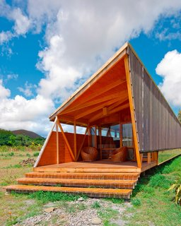 These temporary residences are prefabricated on the mainland before reaching their destination to ensure minimal impact on the environment. Lifted on pillars to further diminish interference with the natural terrain, each hut houses six people.  Easter Island, Chile. By AATA Arquitectos from the book Rock the Shack, Copyright Gestalten 2013.