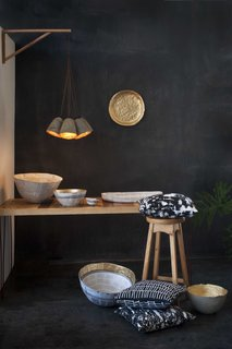 Based in Swaziland, Quazi Design started as a jewelry maker in 2009, and now produces home accessories and furniture. Whether bowls, pendants, or pillows, all of the studio's designs are made out of paper.