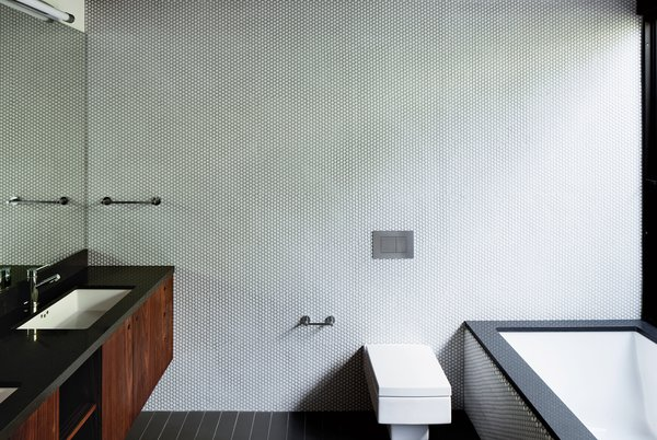 Bath Room, Undermount Sink, One Piece Toilet, and Undermount Tub  Best Photos from A Minimalist Bathroom in Los Angeles