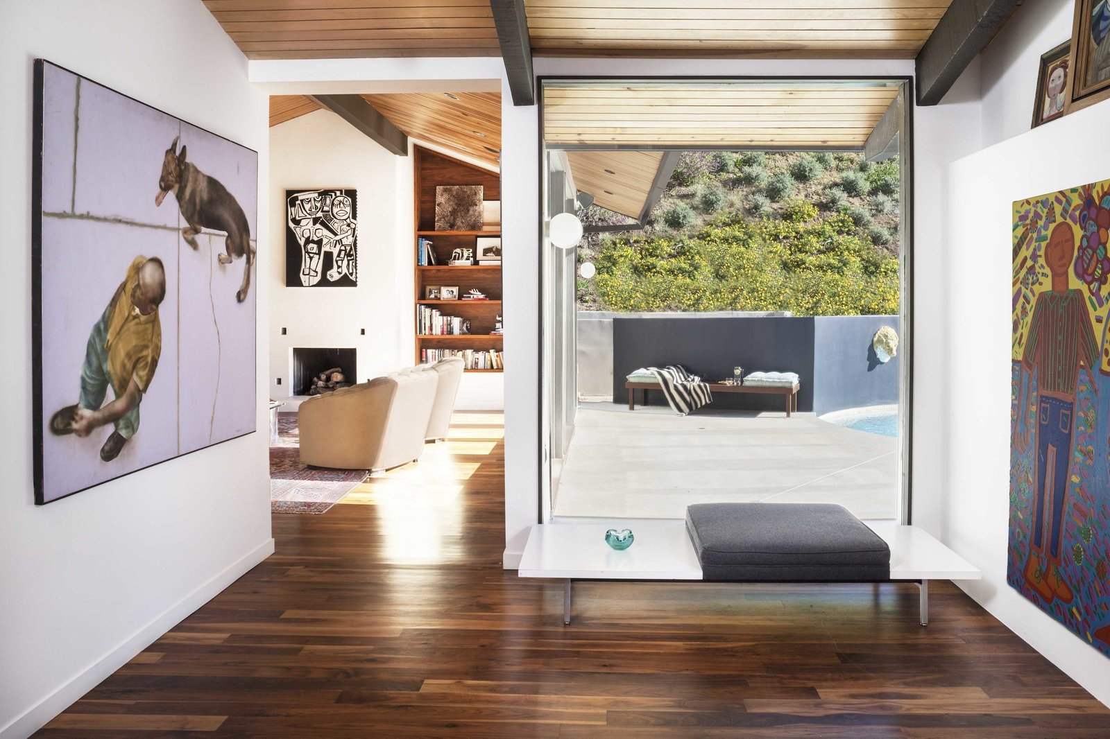 Inside, a Herman Miller bench creates a small sitting area. A rich collection of artwork, amassed over the years by the Saleks' mother, Mahshad, is visible at every turn. The flooring throughout is a warm walnut.  Uses for Walnut in the Modern Home by Zachary Edelson