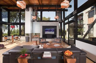 This new build sits on a one-acre, gently sloping lot in the Pasadena foothills, and offers 360-degree views of the San Gabriel Mountains, Los Angeles, and the coastline. The Walker Residence, which won a 2015 AIA Citation award, is completely transparent—all structural elements are visible in its open floor plan. The great room opens to the courtyard, which is perfect for entertaining. The dining room and wine cellar open to an intimate dining patio with a fireplace.