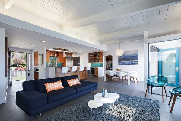 Midcentury architect Frederick Monhoff designed this Santa Monica home in 1951. In the Vukadinovich Residence's most recent renovation, Synthesis, Inc. expanded the previous 1,200-square-feet of living space to a comfortable and bright retreat that totals 2,680-square-feet. The architects added two bathrooms, two bedrooms, and a den, and replaced the existing windows with floor-to-ceiling glass and folding doors that open up completely to the yard.