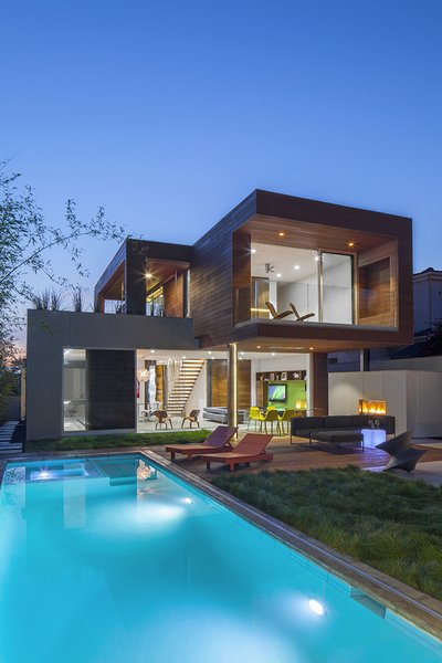 Designed by Minarc for a couple in Santa Monica, the Dawnsknoll residence was built using mnmMOD, a system of prefabricated panels that are recyclable, fire- and termite-proof, and efficient. With the structural panels built ahead of time at the factory, this residence was completed in less than a year. The 2,400-square-foot home champions an indoor-outdoor lifestyle with expansive windows that frame views of the outdoor kitchen and pool. Visitors of Dwell on Design's West Side Home Tour will have the opportunity to see Dawnsknoll firsthand.