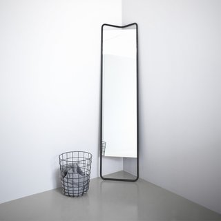 From Menu, The Kaschkasch Floor Mirror is a decidedly modern home accent that is designed with small spaces and apartment living in mind. The full-body mirror has a triangular shaped frame, making it easy to fit into the corner of a room. The thoughtful design also enables the mirror to lean flat against a wall, and even stand on its own in varied directions. There is a gap between the top of the glass mirror and the powder-coated aluminum frame, making it easy to hang clothing or drape scarves, belts, or necklaces.