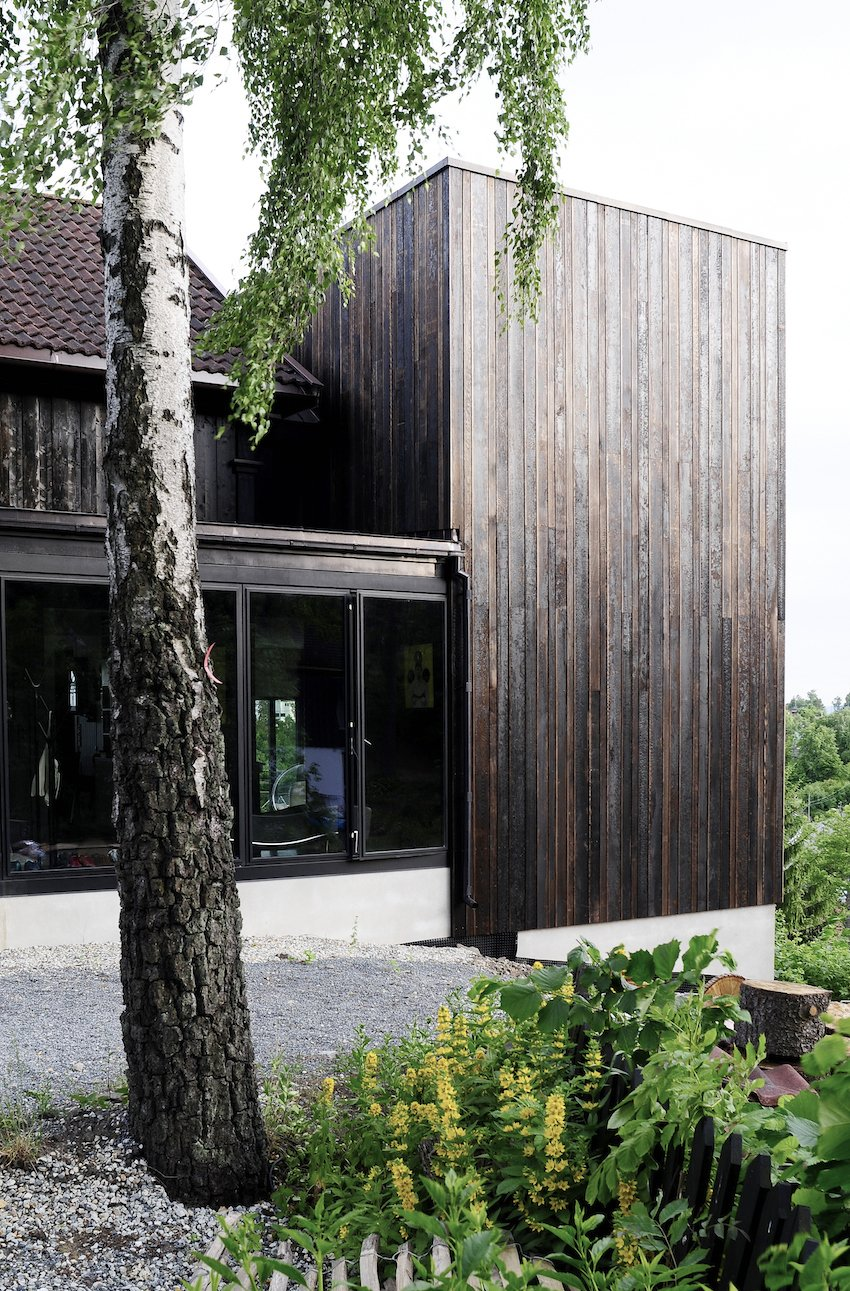 """A simple black box in many ways, the Ankersvingen Annex succeeds with its simplicity; it adds space without subtracting from the surroundings. """"It was a really neat connection between the house and garden, which was totally lacking with the existing architecture,"""" says architect Thor Olav Solbjør of SAAHA. """"We took the stunning views of the fjord as the starting point.""""  Charred Cedar by Patrick Sisson"""