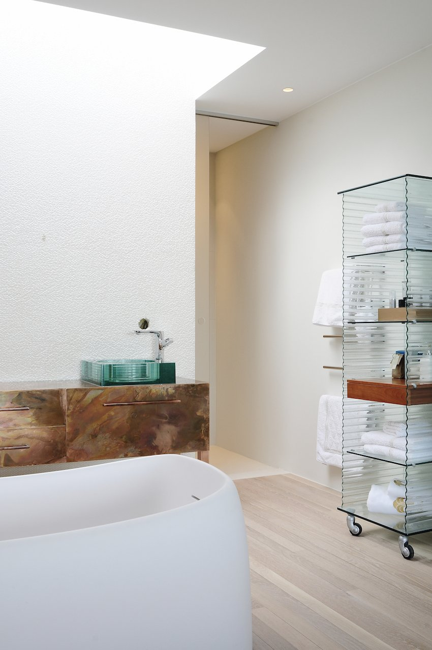 The airy new bathroom contains no traces of the somber exterior finish.  Charred Cedar by Patrick Sisson